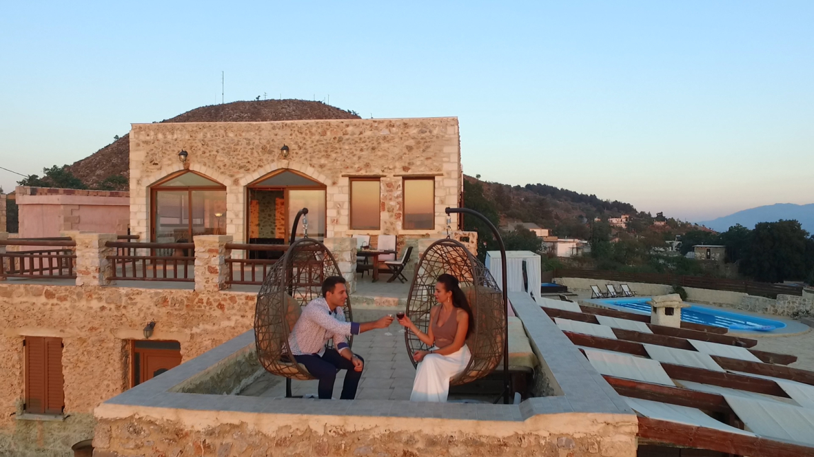 Image to showcase couple relaxing on villa malaxa terace